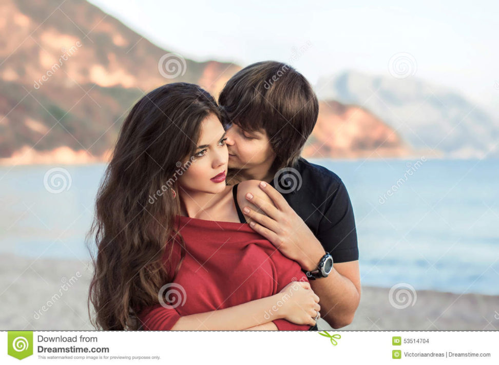 romantic-couple-love-beach-sunset-newlywed-happy-young-lo-lovers-embracing-enjoying-honeymoon-holiday-53514704